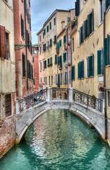 Little bridge across a canal in Venice, Italy