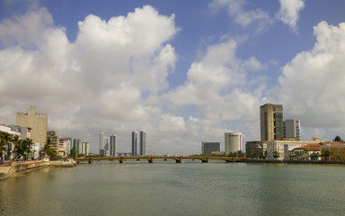 Recife, Brazil - Circa December 2018: A view of Capibaribe river with Mauricio de Nassau bridge and cityscape in the background