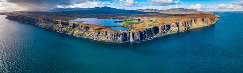 Aerial view of the dramatic coastline at the cliffs by Staffin with the famous Kilt Rock waterfall - Isle of Skye - Scotland Wall mural