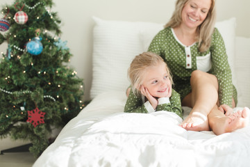 Mother and daughter sitting in bed