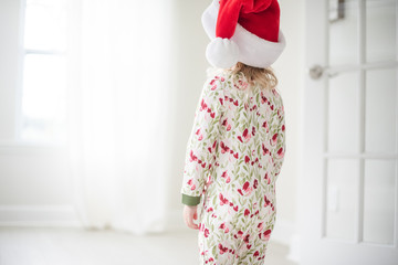 Young girl wearing a Santa hat