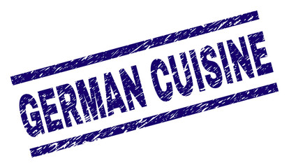 GERMAN CUISINE seal print with distress style. Blue vector rubber print of GERMAN CUISINE label with grunge texture. Text label is placed between parallel lines.