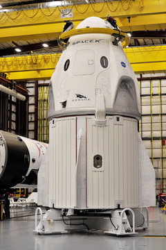 The Dragon crew capsule sits in the SpaceX hangar at Launch Complex 39-A, where the space ship and Falcon 9 booster rocket are being prepared for a January 2019 launch at Cape Canaveral