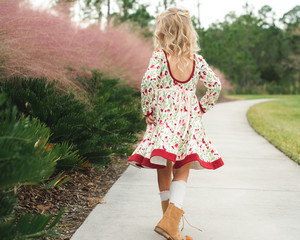 Young girl in a floral dress walking
