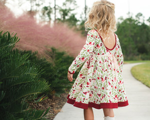 Rear view of a girl in a floral dress