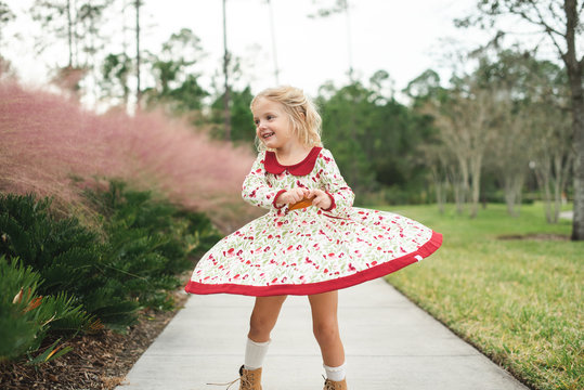 Young girl twirling in her floral dress