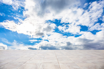 Wall Mural - Business concept - Empty concrete floor top with morning grey bright cloud sky for display or montage product