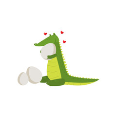 Young green cute cheerful crocodile spends his free time.