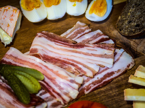 Bacon snack on a wooden snack plate