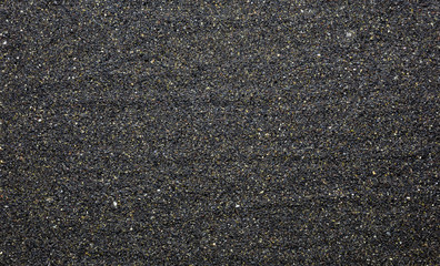 Black sand background closeup