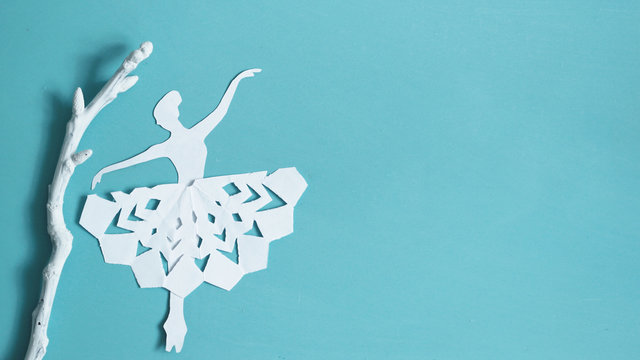 Ballet dancer silhouette, Christmas or winter background with snowflakes.