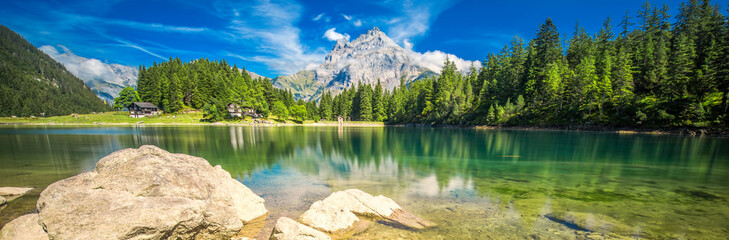 Foto auf Acrylglas Alpen Arnisee with Swiss Alps. Arnisee is a reservoir in the Canton of Uri, Switzerland, Europe