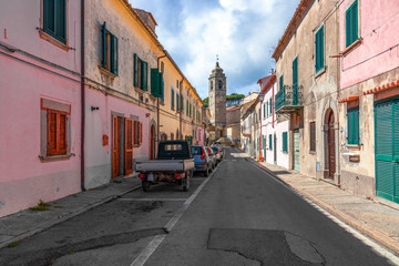 POGGIO, ELBA ISLAND, ITALY - SEPTEMBER 16, 2018: Small street with colorful houses in a town Poggio on Elba island.