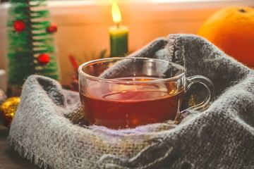 festive tea party. a cup of tea on the background of New Year and Christmas decorations.