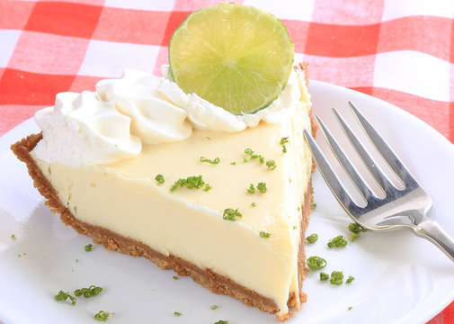 Closeup of Piece of Key Lime Pie Garnished with Lime Slice and Zest