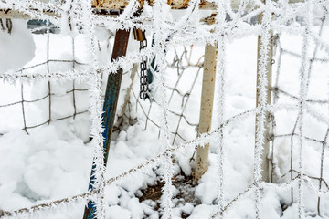 The football goal net, covered with hoarfrost