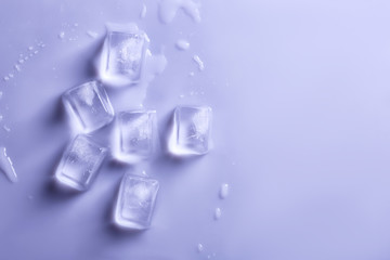 Ice cubes on color background, top view. Space for text