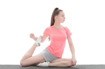 practice of yoga. young woman in sports clothing training yoga position