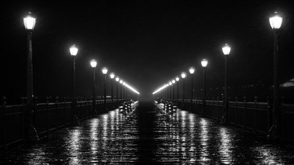black and white pier at night in the rain Fotomurales