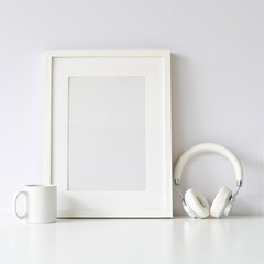 Mockup white poster frame on white table