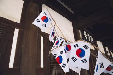 Independence Hall and Korean national flag Taegeukgi at Seodaemun Independence Park in Seoul, Korea
