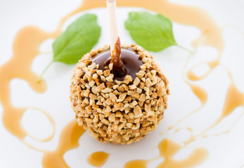 Peanut Caramel Apples with Mint Leaves on a White Background