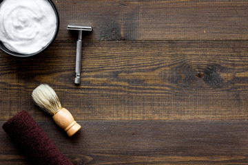 Instruments of male hairdresser barbershop top view on wooden background copyspace
