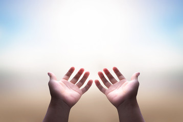Prayer and worship concept: Christian man with open hands worship christian