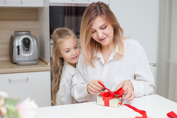 Daughter giving her mother a christmas present