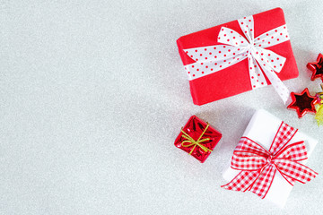 Christmas New year theme decorated red and craft gift box ribbon bow on white glitter background with copy space for text.Displaying picture.