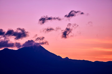Mountain peaks and clouds at sunrise time