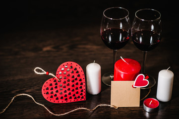 Blank, craft paper, candle, red heart, rope, wine on brown wooden background with space. Place for text. concept Women's Day, eighth of March. Wedding, jubilee. Love.