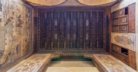Wooden ceiling decorated with floral pattern decorations, mural, and built-in wooden cupboards at ottoman historic Beit El Set Waseela building (Waseela Hanem House), Old Cairo, Egypt