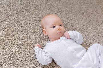 Family, baby and infant concept - Close up portrait of little child on the floor
