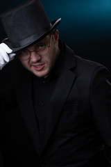 Picture of happy man in black hat in white gloves