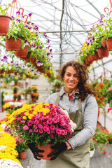Smiling Florist working in green house