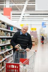 elderly man with   trolley in   supermarket