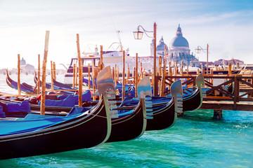 Canal with gondolas in Venice, Italy. Sunny day. romantic travel.