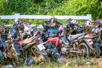The pile rusty motorcycles in the junkyard