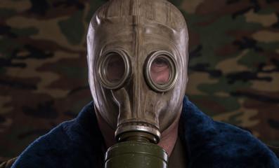 studio portrait of a man in gas mask