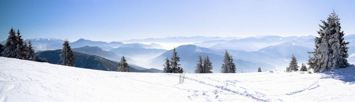 Panorama of snowy winter mountain, Alpine mountains in winter, Beautiful winter snowy mountains