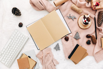 Blogger Christmas composition with decorations. Flat lay on white cozy background, copy space. Notebook, keyboard, holiday concept