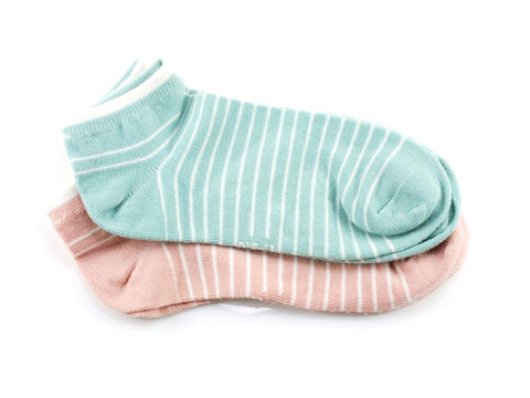 striped green and pink socks isolated on white background