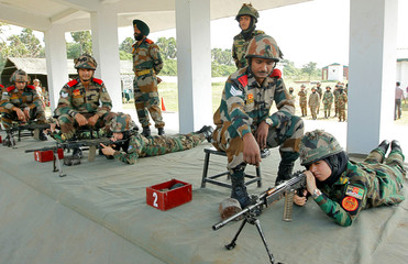 Afghan women army cadets shoot a target during a practice session at the Officers Training Academy as part of the Indian military training programme for female Afghan army cadets, in Chennai