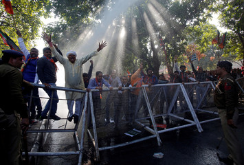 """Supporters of India's ruling BJP shout slogans during a protest against what they call """"disinformation"""" by India's main opposition Congress party on a deal to buy Rafale fighter planes from a French company, in Chandigarh"""