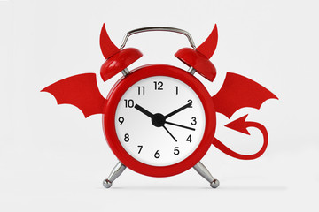 Devil alarm clock on white background