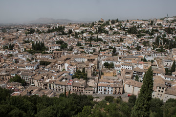View oView From Top of Palacio Nazares at Granada, Spain. The bird's eye view of the city with lush greeneries look amazing. The day seems to be sunny.