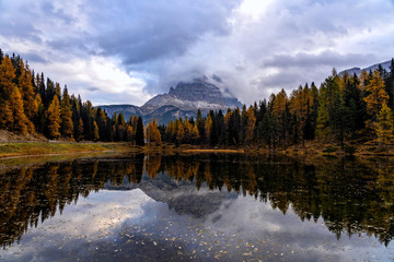 Wall Mural - Autumn landscape of Antorno lake with famous Dolomites mountain peak of Tre Cime di Lavaredo in background in Dolomites, Italy. Beautiful nature scenery and scenic travel destination in Fall time.
