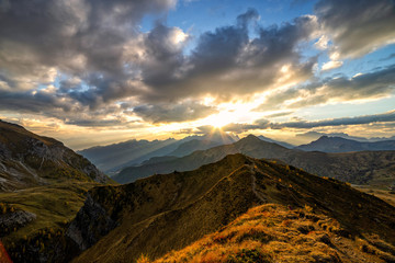 Wall Mural - Beautiful sunset shot of majestic Dolomites mountains in Italian Alps. Landscape shot of high rocky mountains in the the Italian Dolomites during Autumn time.