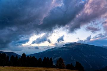 Fototapete - Beautiful sunset shot of majestic Dolomites mountains in Italian Alps. Landscape shot of high rocky mountains in the the Italian Dolomites during Autumn time.
